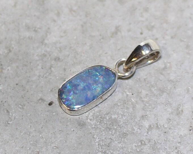 Australian Boulder Opal Pendant set in sterling silver 6x12mm