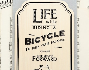 Riding a Bicycle Wooden Plaque