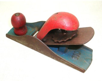 """Small Vintage Planer. 6.5"""" long. Only marked with 110 on the base. Original red and blue paint is wearing off a bit. Blade needs sharpening"""