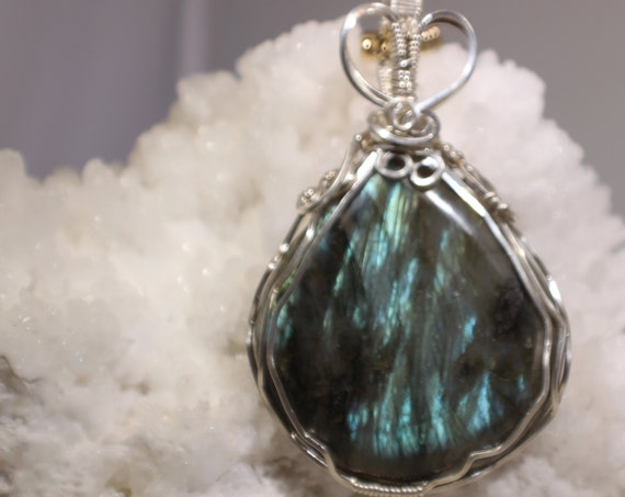Very large, bright flash Labradorite.  Wire wrapped in Sterling Silver