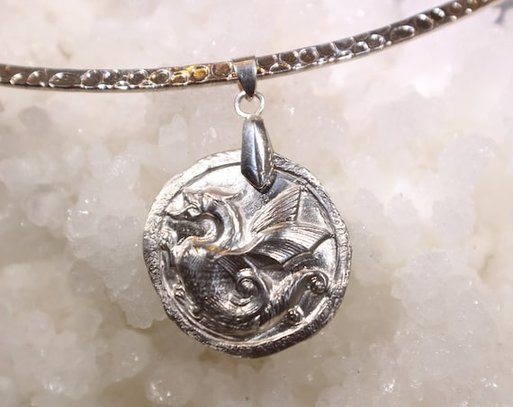 Fine silver (.999 pure) Dragon Pendant made from precious metal clay.