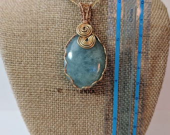 Aquamarine pendant wire wrapped in gold filled wire.  The pendant has a 2 1/4 inch drop.