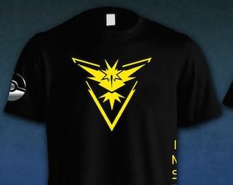 f00870b3 Pokemon Go - Black Team Instinct Dry Fit Shirt w/ Reflective Pokeball on  Sleeve