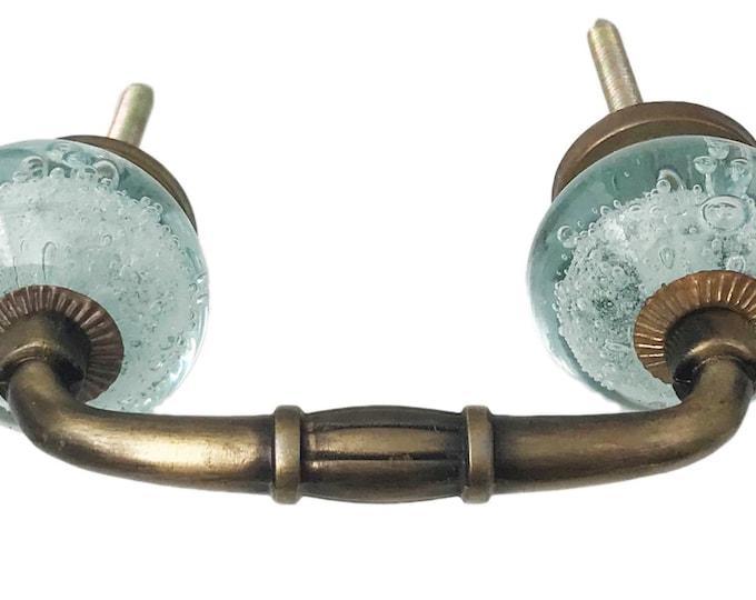 "Light Blue Bubble Glass Knobs on a Bronze Metal Decorative Handle, 3"" Spread"