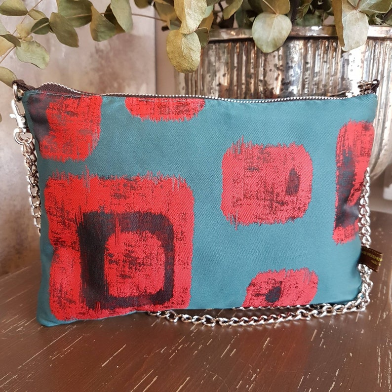 Octanium green shoulder bag with red geometric designs  image 0