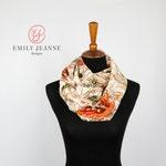 Mariposa Chiffon Fashion Infinity Scarf featuring orange butterflies on a pale peach background