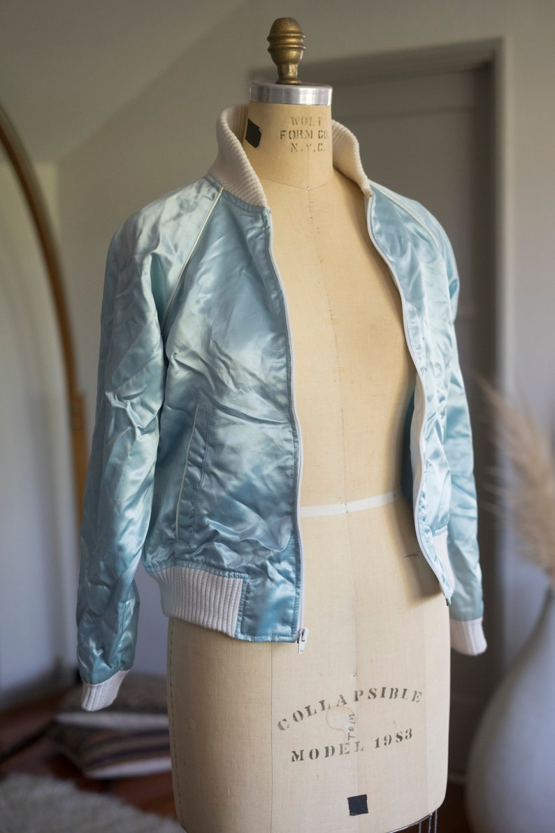 electric baby...blue! Blue Flame  vintage blue satin bomber jacket Beautiful condition \u2013