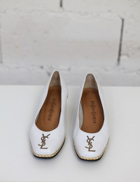 Pair of Yves Saint Laurent leather shoes