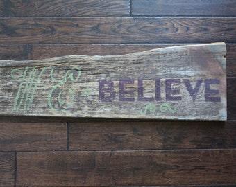 Reclaimed barn wood We Believe sign