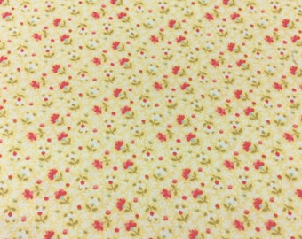 Cotton fabric, yellow background with shades of red, pink, and cream flowers. 04286-1