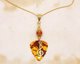 Guitar Pick With Treble Clef Pendant On Gold Plated Snake Chain Necklace