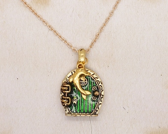 Hobbit Door Pendant With Dolphin On Gold Tone Chain Necklace