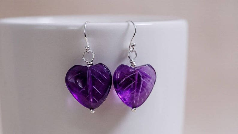 Thick dark purple genuine amethyst in heart shape with carved image 0
