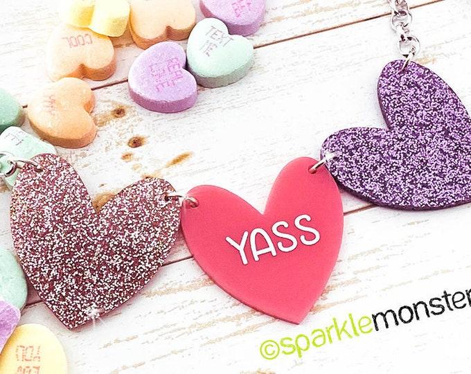 YASS - 1 of 1 necklace, light pink glitter, purple hearts