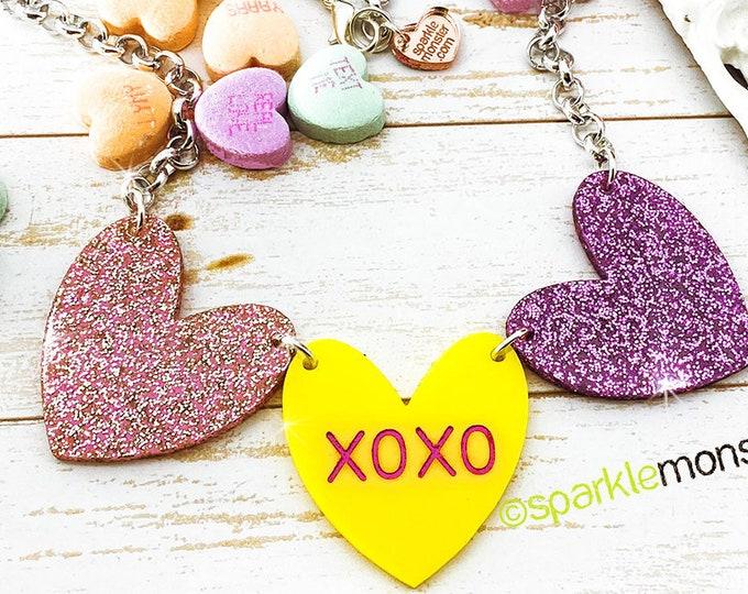 XOXO - 1 of 1 necklace, light pink glitter, purple, yellow hearts