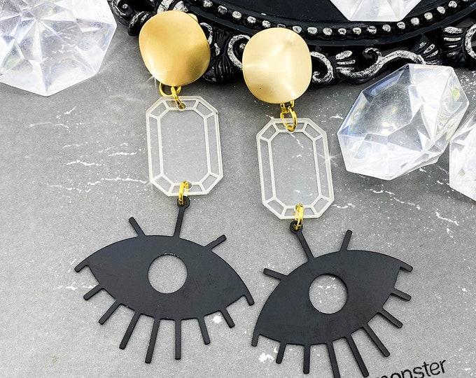 Eye See You - gold and matte black dangle earrings