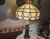 Vintage brass table lamp with olive green and opal glass slag shade