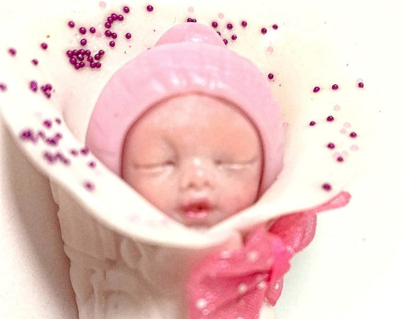baby in white angel's nest - fimo - pregnancy announcement - godmother godmother gift