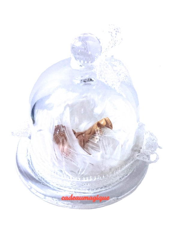 Glass bell with baby girl on bed of feathers: adorable deco