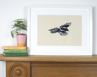 A detailed free motion or freehand machine embroidery of a magpie, framed