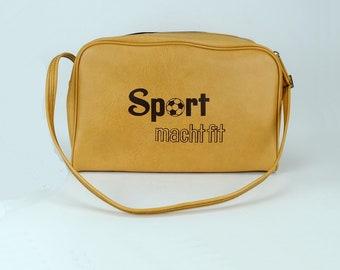 1b09d4d6faa3 1970s vintage sport shoulder bag with slogan  Sport macht fit