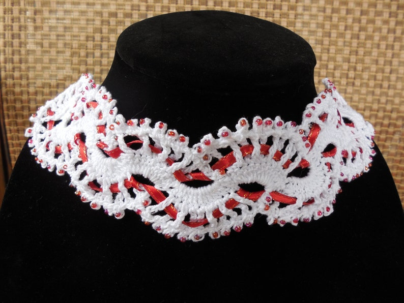 Victorian inspired white and red ribbon with opalescent red glass accent beads. Gothic Beautiful handmade crochet and beaded choker