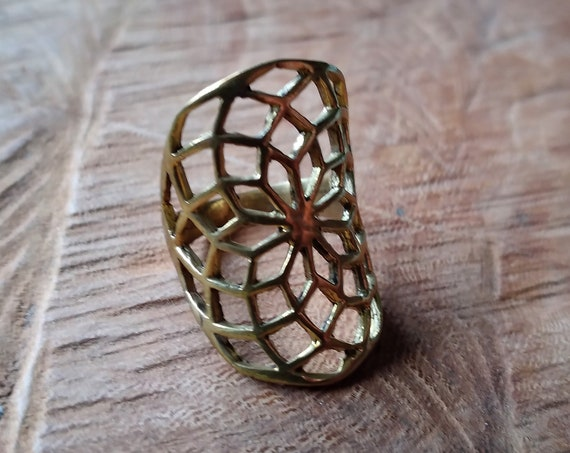 Torus ring in brass, sacred geometry