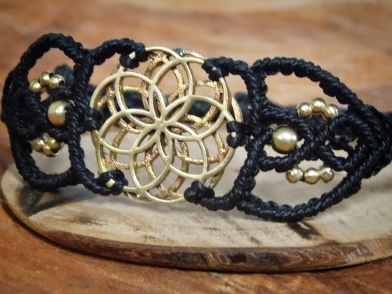 Macrame bracelet with seeds of life from brass, black yarn, sacred geometry