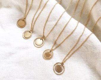 AURORA NECKLACE / GOLD ~ sun medallion radiates lights and signifies new beginnings