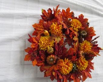 Bright maple orange wreath:  faux-silk-artificial flowers and leaves; fall-autumn grapevine wreath; pumpkins and squash