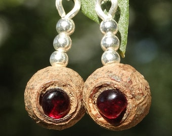 Earrings made of eucalyptus seed pods, garnets and sterling silver spheres