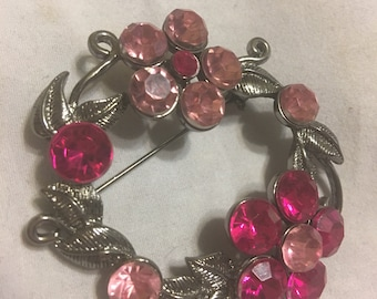 Pretty composite rhinestone brooch from the late 1980s pink and fuscia