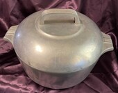 Wagner magnalight cast aluminum Dutch oven with metal handled lid