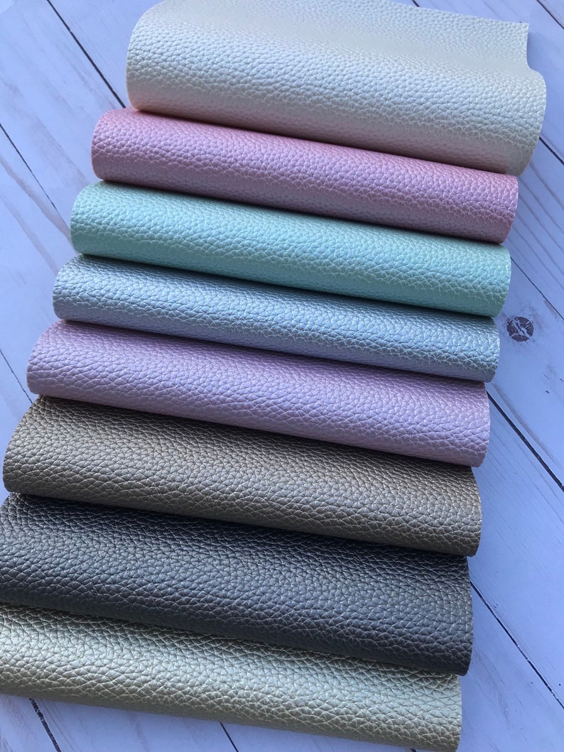 Pearl litchi design faux leather. Faux leather pearl leather. Litchi leater. Leather sheets craft supplies. Gold, silver, pink, white, lilac photo