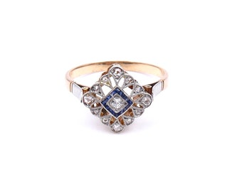 Antique Sapphire ring with diamonds set in platinum with an open work lace setting, Art Deco sapphire ring.