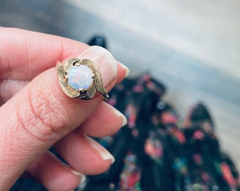 Antique opal gold ring, an unusual vintage opal ring with an engraved setting that frames the opal.