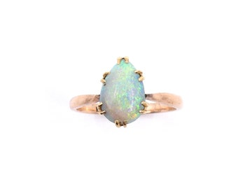 Vintage opal and rose gold ring, with a blue-green iridescent opal cabochon.