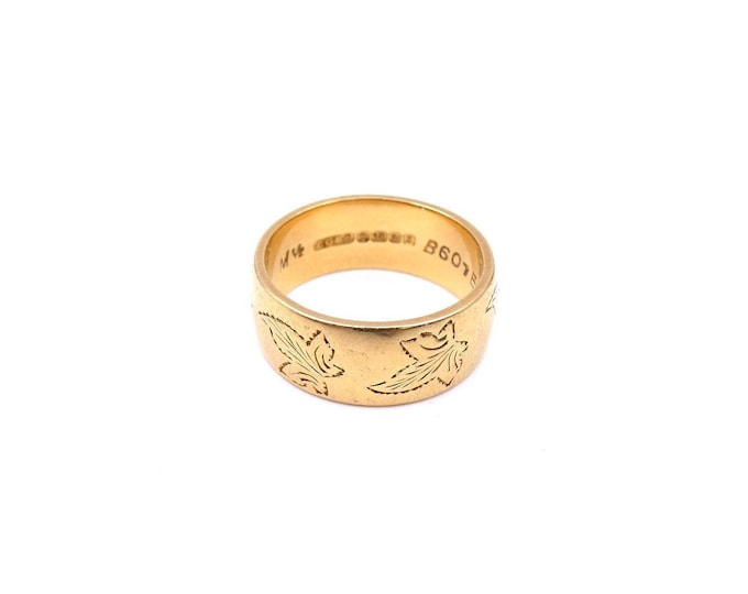 Featured listing image: A vintage heavy 18kt gold ring, engraved with a pattern of ivy leaves.