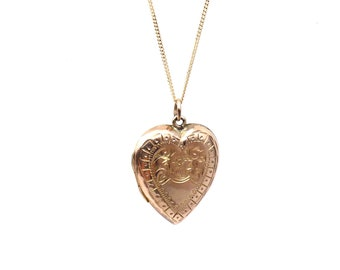 Antique rose gold heart locket, engraved heart back and front gold locket with a pretty floral pattern and border.