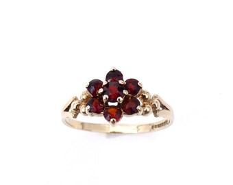 Vintage garnet and gold flower cluster ring in 9 carat gold, a vintage delicate gold ring.