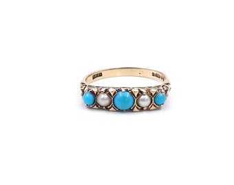 Vintage pearl and turquoise ring in a victorian style 9kt gold mount with decorative sides.