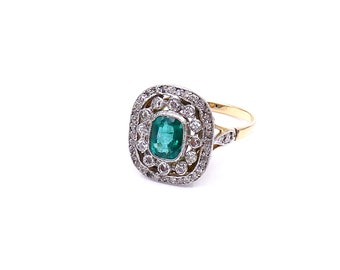 Emerald and diamond cluster ring, an antique style ring set in 18kt gold.