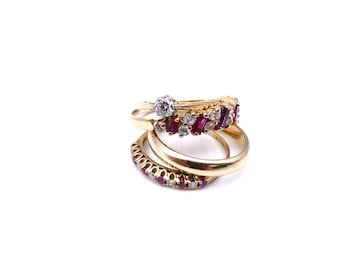 A baguette ruby and cubic zirconia eternity ring.