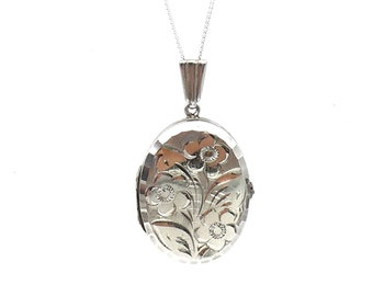 Vintage silver locket, engraved decorative locket in silver on a fine chain, with a floral motif.