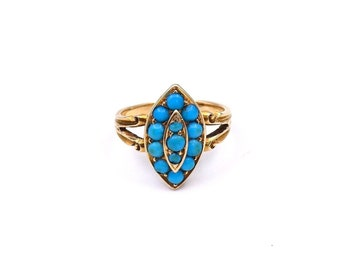 A victorian turquoise and gold ring, a navette shaped setting.