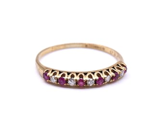 Vintage diamond spinel half eternity ring in 9kt gold.