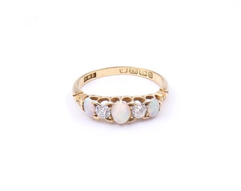 Antique opal and diamond five stone ring set in 18kt gold, a victorian opal ring.