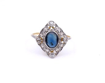 Art Deco sapphire ring with diamonds set in 18kt white and yellow gold.