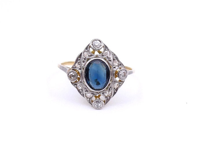 Featured listing image: Art Deco sapphire ring with diamonds set in 18kt white and yellow gold.