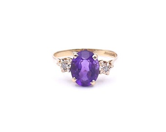 Vintage amethyst, diamond and 9kt gold ring, an oval amethyst ring.